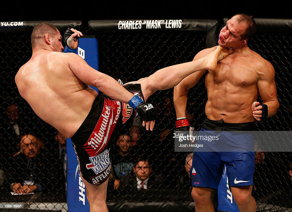 Cain Velasquez kicks Junior dos Santos during their heavyweight championship fight at UFC 155 on December 29, 2012 at MGM Grand Garden Arena in Las Vegas, Nevada.