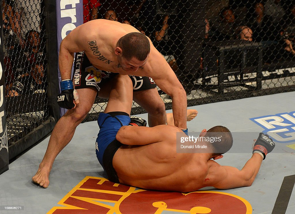 <a gi-track='captionPersonalityLinkClicked' href=/galleries/search?phrase=Cain+Velasquez&family=editorial&specificpeople=5445619 ng-click='$event.stopPropagation()'>Cain Velasquez</a> punches Junior dos Santos during their heavyweight championship fight at UFC 155 on December 29, 2012 at MGM Grand Garden Arena in Las Vegas, Nevada.