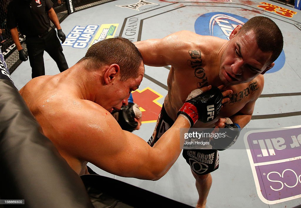 Cain Velasquez punches Junior dos Santos during their heavyweight championship fight at UFC 155 on December 29, 2012 at MGM Grand Garden Arena in Las Vegas, Nevada.