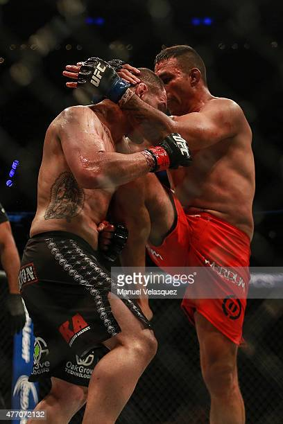 Cain Velasquez receives a knee hit from Fabricio Werdum during a UFC Heavyweight Championship Fight between Cain Velasquez and Fabricio Werdum at...