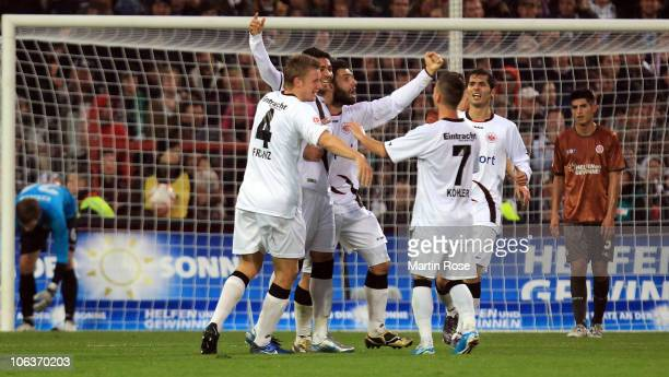 Caio celebrate after he scores his team's 3rd goal of Frankfurt battle for the ball during the Bundesliga match between FC St Pauli and Eintracht...