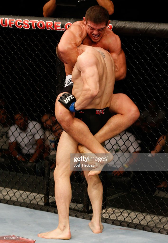 Caio Magalhaes (top) attempts a guillotine choke against Karlos Vemola in their middleweight fight during the UFC on FUEL TV event at Paulo Sarasate Arena on June 8, 2013 in Fortaleza, Ceara, Brazil.
