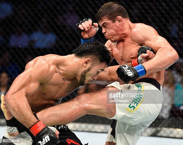 Caio Magalhaes of Brazil lands a kick to the torso of Brad Tavares in their middleweight bout during the UFC 203 event at Quicken Loans Arena on...