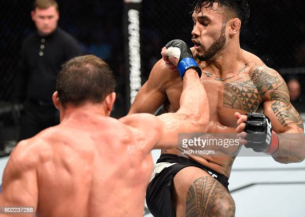 Caio Magalhaes of Brazil punches Brad Tavares in their middleweight bout during the UFC 203 event at Quicken Loans Arena on September 10 2016 in...