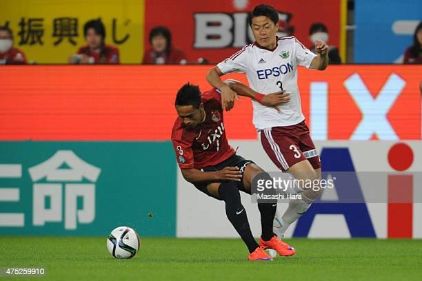 Caio of Kashima Antlers and Hayuma Tanaka of Matsumoto Yamaga compete for the ball during the JLeague match between Kashima Antlers and Matsumoto...