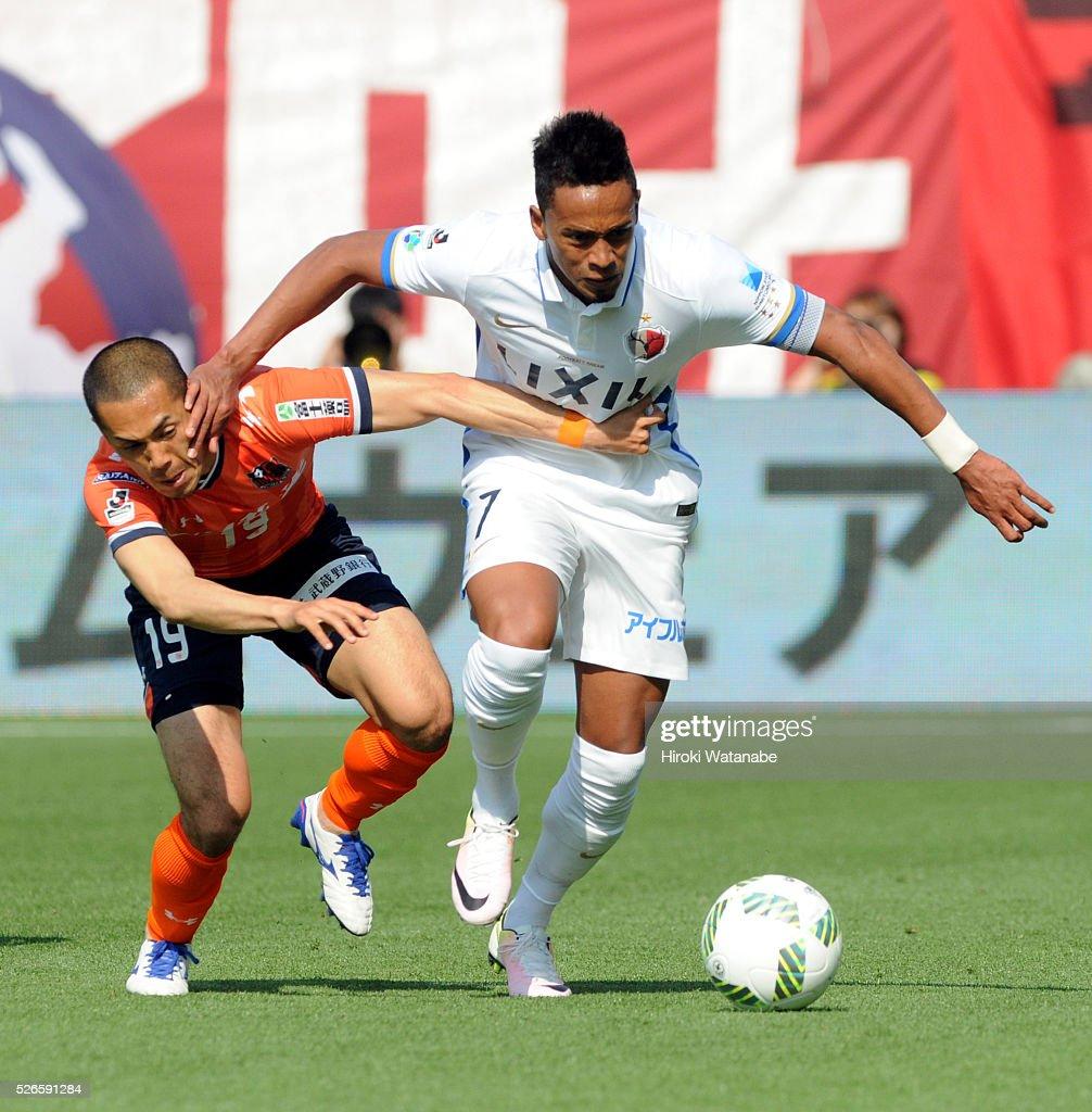 Caio of Kashima Antlers and Ryo Okui of Omiya Ardija compete for the ball during the J.League match between Omiya Ardija and Kashima Antlers at Nack 5 Stadium Omiya on April 30, 2016 in Saitama, Japan.
