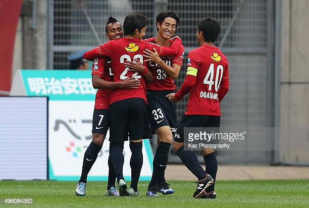 Caio of Kashima Antlers celebrates scoring his team's first goal with his team mates during the JLeague match between Kashima Antlers and Yokohama...