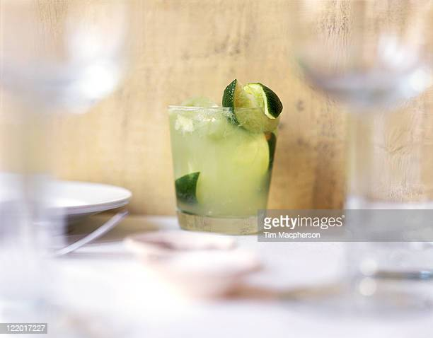 Caipirinha cocktail with lime twist
