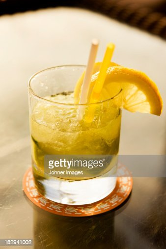 Caipirinha drink garnished with lemon slices : Stock Photo