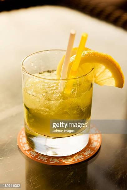 Caipirinha drink garnished with lemon slices