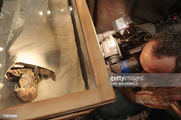 A cameraman records the mummified remains of Queen Hatshepsut ancient Egypts most famous female pharaoh after being unveiled at the Cairo Museum 27...