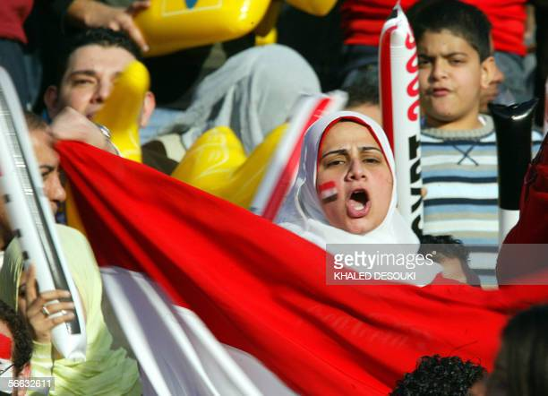 An Muslim Egyptian soccer fan waves a national flag during the opening ceremony of the 25th African Nations Cup in Cairo 20 January 2006 Football...