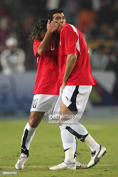 Egypt football star Ahmed 'Mido' Hossam is comforted by his teammate Emad Moteb as he leaves the field due to an injury during a knockout round...