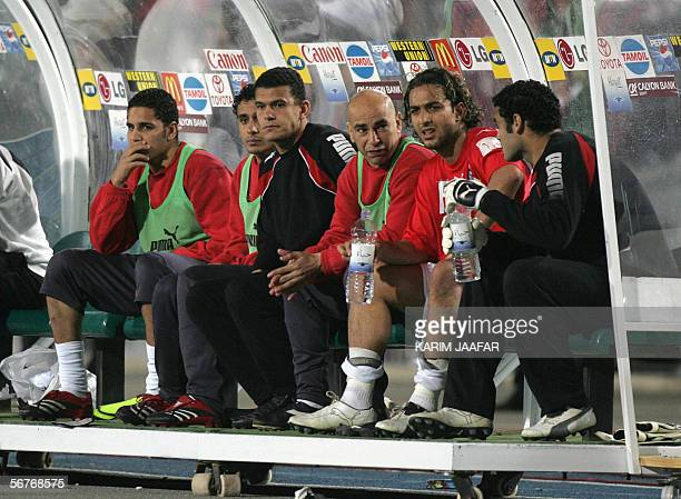 Egypt star striker Ahmed 'Mido' Hossam player in Tottenham sits in the bench next to Hossam Hassan a legend in the national football at 40 years of...