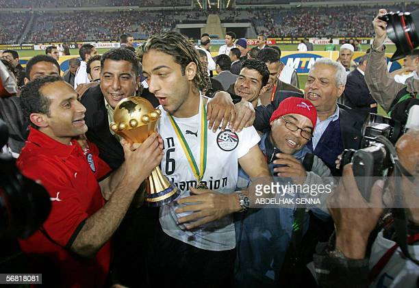 Egypt star striker Ahmed 'Mido' Hossam player in Tottenham carries the trophy celebrating his team victory against the Ivory Coast Elephants 42 in...