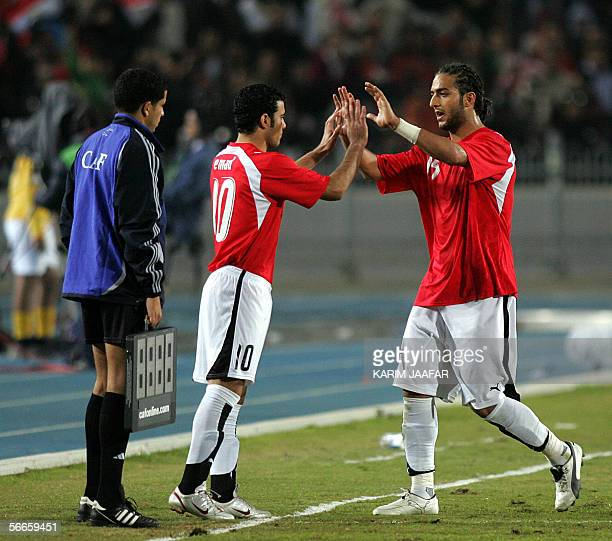Egyptian football star Ahmed 'Mido' Hossam Mido greets his replacement Mohammed Ibrahim during their Group A African Nations Cup football match...