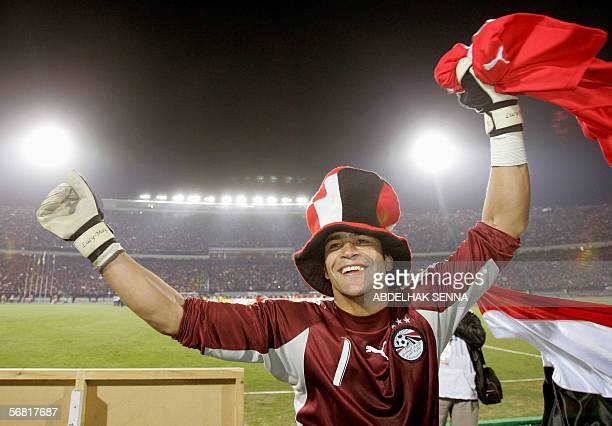 Egyptian goalkeeper Essam El Hadari celebrates after his team won against the Ivory Coast Elephants 42 in penalties in the final game of the African...