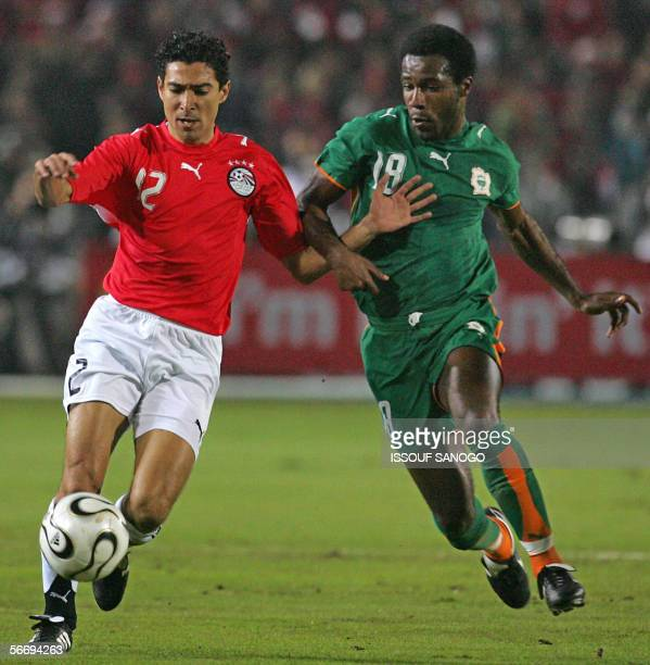 Egyptian player Mohamed Barakat vies with Ivory Coast's Siaka Tiene during their African Nations Cup knockout round football match in Cairo 28...