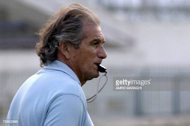 Egypt's alAhly club Portuguese coach Manuel Jose whistles during a training session on the eve of their football match against FC Barcelona in Cairo...