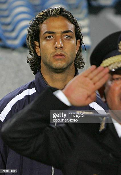 Egypt's star striker Ahmed 'Mido' Hossam player in Tottenham listens to the national anthem as he stands close to the pitch to watch the final...