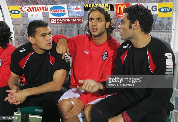 Egypt's star striker Ahmed 'Mido' Hossam watches the action in the field while sitting on the bench during the quarterfinals game between the...