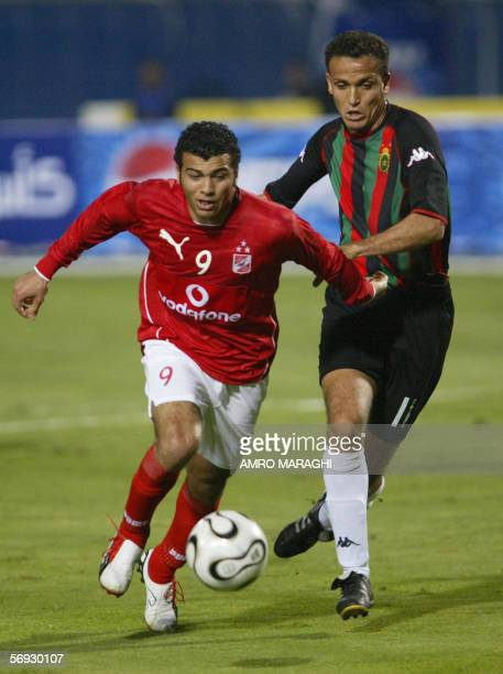 Emad Meteb of Egypt's AlAhly club the African League Champion vies with an unidentified player of the Royal Armed Forces club of Morocco winner of...