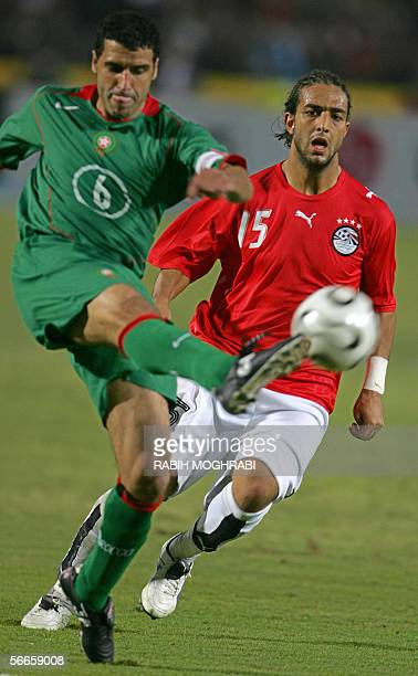 Moroccan Nybet Noureddine kicks the ball away from Egyptian football idol Ahmed 'Mido' Hossam during their Group A African Nations Cup football match...