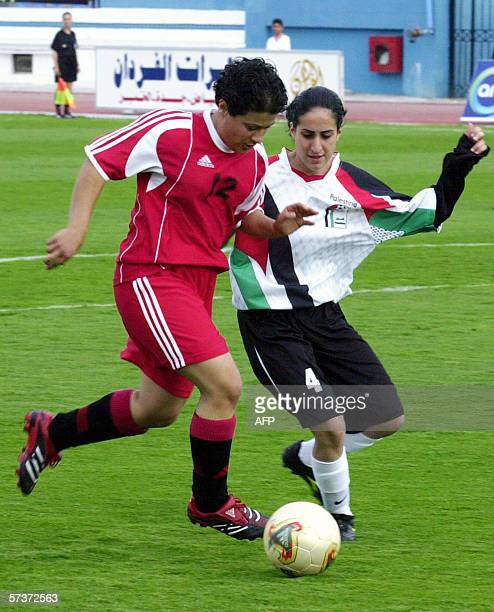 Syrian player Randa Muhager vies with Palestinian Haya Mussa during their national teams' football match at the First Arab Women Football...