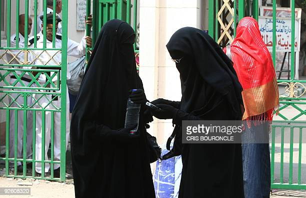 Cairo University students wearing the niqab a black veil which covers the face except for the eyes stand outside the university dormitory on October...