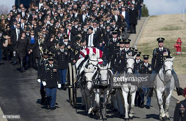 A caisson carries the casket of US Army Staff Sgt James F Moriarty during a burial service at Arlington National Cemetery in Arlington Virginia...