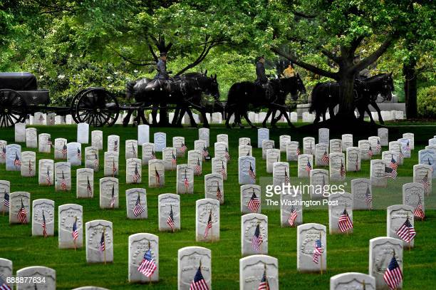 A caisson that had just completed a ceremony nearby passes some of the thousands of headstones that had flags placed next to them More than 1000...