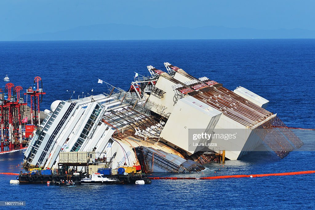 Caissons attached to the side of the stricken Costa Concordia and the cabling used to pull the ship upright are seen as the parbuckling project to raise the ship continues on September 16, 2013 in Isola del Giglio, Italy. Work begins today to right the stricken Costa Concordia vessel, which sank on January 12, 2012. If the operation is successful, it will then be towed away and scrapped. The procedure, known as parbuckling, has never been carried out on a vessel as large as Costa Concordia before.