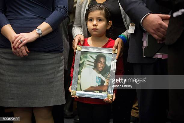 Caitlin Aguilar holds a photo of Teshawn Samuel who was shot by four assailants while delivering invitations to his daughter's birthday party in...