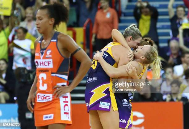 Caitlin Bassett Laura Sherian and Kelsey Browne celebrate victory with their teammates at the final whistle during the Super Netball Grand Final...