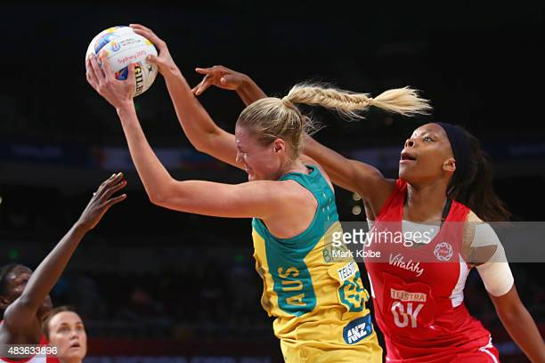 Caitlin Bassett of Australia and Eboni BeckfordChambers of England compete for the ball during the 2015 Netball World Cup Qualification round match...