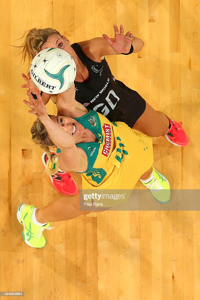 Caitlin Bassett of Australia and Leana de Bruin of New Zealand contest for the ball during the International Test Match between the Australian...