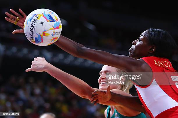 Caitlin Bassett of Australia and Sonia Mkoloma of England compete for the ball during the 2015 Netball World Cup Qualification round match between...