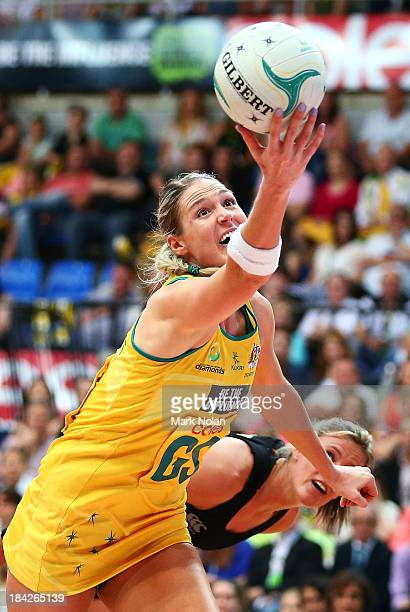 Caitlin Bassett of Australia reaches for possession during game five of the Constellation Cup series between the Australian Diamonds and the New...
