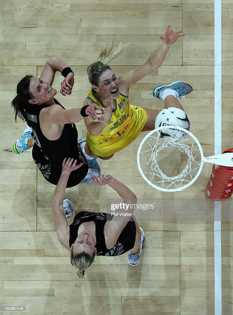 Caitlin Bassett of the Australia Diamonds and Leana de Bruin and Katrina Grant of the Silver Ferns compete for the ball during the Constellation Cup...