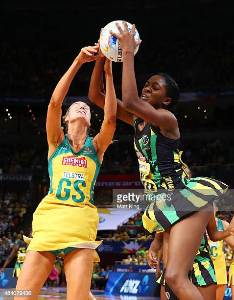 Caitlin Bassett of the Diamonds competes with KadieAnn Dehaney of Jamaica during the 2015 Netball World Cup Semi Final 2 match between Australia and...