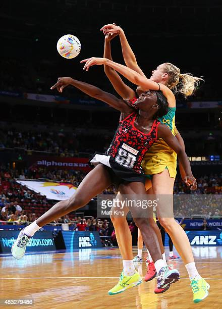 Caitlin Bassett of the Diamonds competes with Kemba Duncan of Trinidad Tobago during the 2015 Netball World Cup match between Australia and Trinidad...