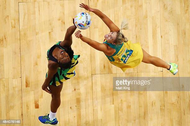 Caitlin Bassett of the Diamonds competes with Stacian Facey of Jamaica during the 2015 Netball World Cup Semi Final 2 match between Australia and...