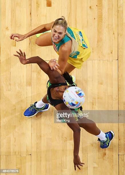 Caitlin Bassett of the Diamonds competes with Vangelee Williams of Jamaica during the 2015 Netball World Cup Semi Final 2 match between Australia and...