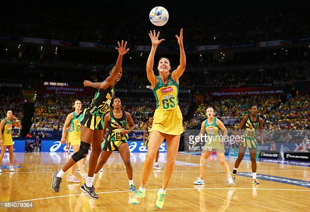 Caitlin Bassett of the Diamonds is challenged by KadieAnn Dehaney of Jamaica during the 2015 Netball World Cup Semi Final 2 match between Australia...