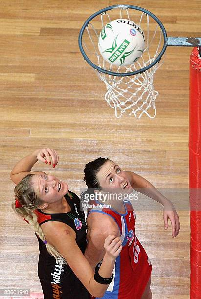 Caitlin Bassett of the Fever and Susan Pratley of the Swifts watch the ball into the net during the round 12 ANZ Championships match between the NSW...