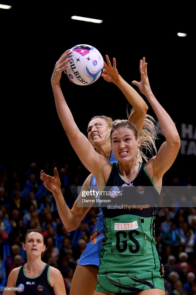Caitlin Bassett (R) of the Fever grabs the rebound ahead of Jane Watson of the Steel during the ANZ Championship match between the Steel and the Fever on April 30, 2016 in Invercargill, New Zealand.