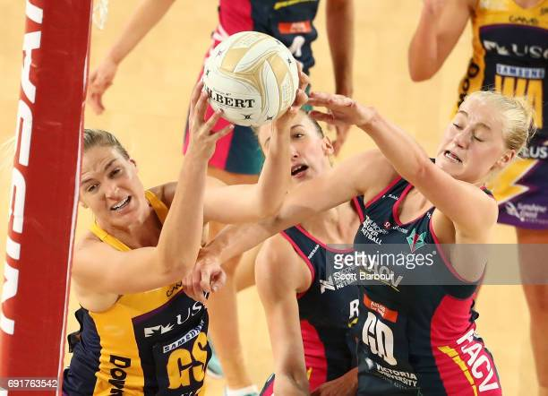 Caitlin Bassett of the Lightning and Emily Mannix of the Vixens compete for the ball during the Super Netball Major Semi Final match between the...