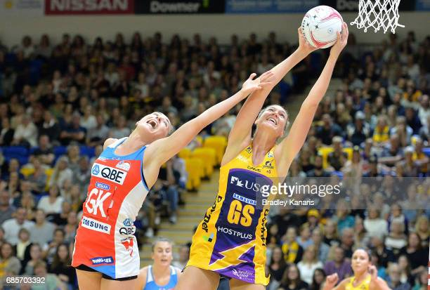 Caitlin Bassett of the Lightning and Sarah Klau of the Swifts challenge for the ball during the round 13 Super Netball match between the Lightning...