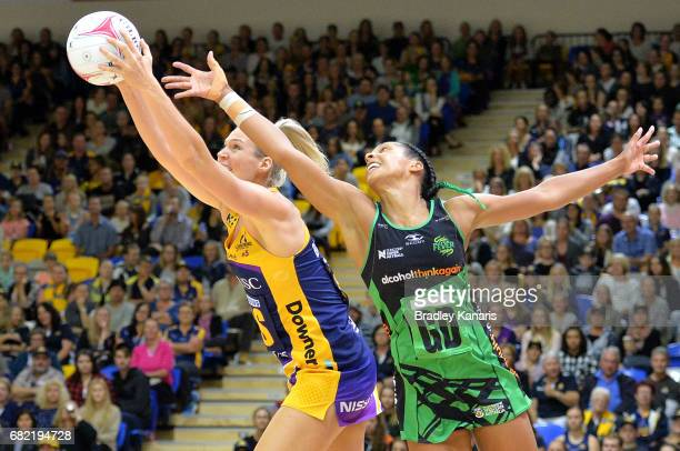 Caitlin Bassett of the Lightning and Stacey Francis of the Fever compete for the ball during the round 12 Super Netball match between the Lightning...