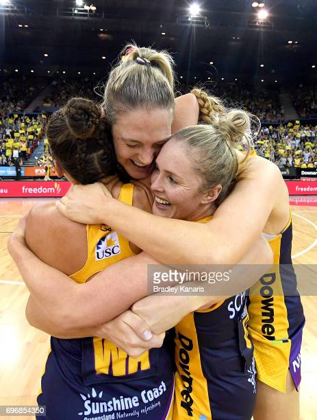 Caitlin Bassett of the Lightning and team mates celebrate victory after the Super Netball Grand Final match between the Lightning and the Giants at...